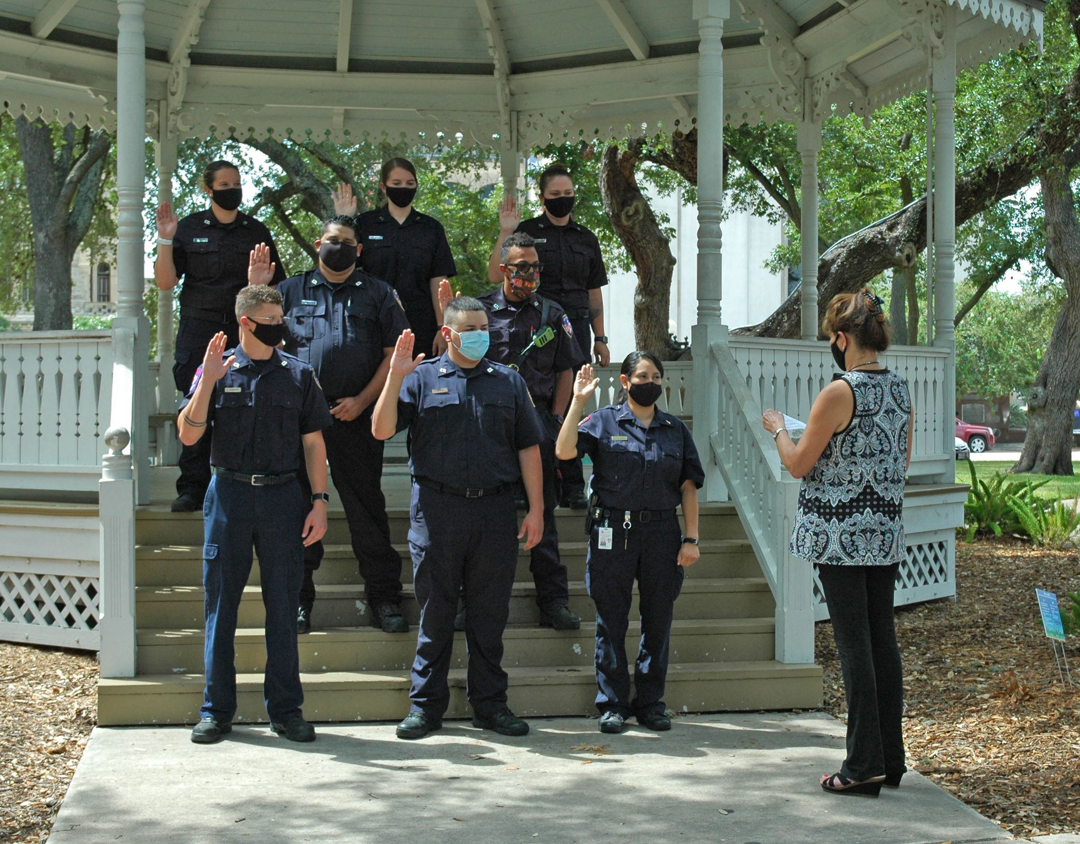 Eight fire department recruits are sworn in at the DeLeon Plaza gazebo
