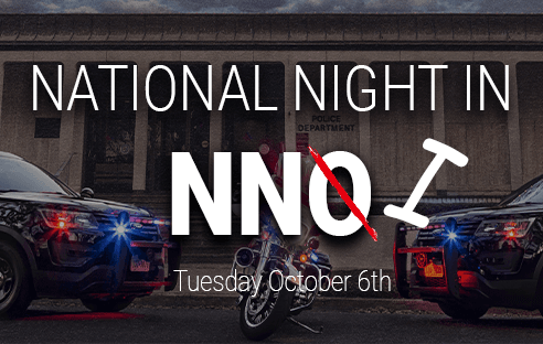 "Police cars in front of City Hall. ""N.N.O."" is crossed out to read ""N.N.I."" Text: Tuesda"