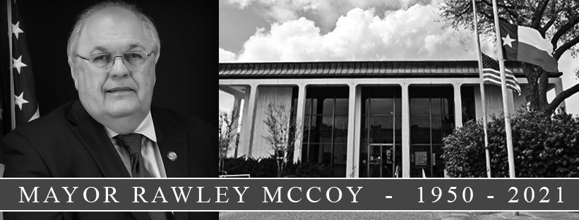 Portrait of Mayor Rawley McCoy 1950-2021 and flags at City Hall at half-staff