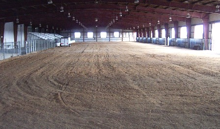 Arena with dirt floor and bleacher seating